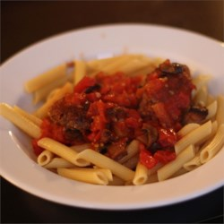 Penne and Meatballs All'Arrabbiata Recipe - Penne pasta tossed in a spicy homemade tomato sauce with big meatballs makes this a favorite weeknight meal.