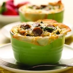 Baked Egg Cups with Country Style Chicken Sausage Recipe - Phyllo-dough cups filled with country style chicken sausage, eggs, and spinach and topped with shredded cheese are a delicious way to start your day!