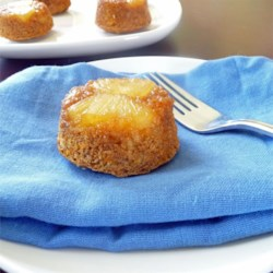 Pineapple Upside-Down Muffins Recipe - Carrot muffins are baked on top of glazed pineapple and then served upside-down, just like the cake!