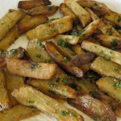 Oven Baked Garlic and Parmesan Fries Recipe - Parmesan cheese, parsley, and even more Parmesan cheese coat these delicious oven-baked fries.