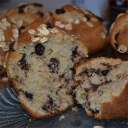 Chocolate Chip Muffins II Recipe - These wonderfully moist and sweet muffins are made with milk, yogurt and a scoop of chocolate chips.