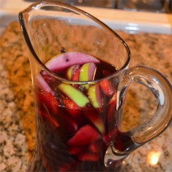 Amanda's Sangria Recipe - Red wine punch marinated with fruit and flavored with cloves. Mix with lemon-lime soda and serve.