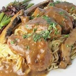Chicken Marsala with Portobello Mushrooms Recipe - Portobello mushrooms and chicken are baked in a savory wine sauce.