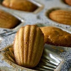 French Butter Cakes (Madeleines) Recipe - Use this recipe to follow along with the video to make sponge cake-like French madeleine cookies in shell-shaped molds.