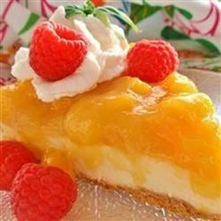 Trini Mango Cheesecake Recipe - This is a Caribbean twist on a classic dessert. Use firm, ripe mangoes, not mushy or half ripe ones. This is a great recipe to try because it's quick and simple to prepare. I used a ready made crust because it makes prep time shorter and really a graham cracker crust is perfect for cheesecakes.
