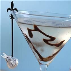 Chocolate Martini a la Laren Recipe - Chocolate liqueur and vodka are shaken with ice and garnished with chocolate shavings.