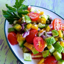 Cucumber Salad with Dill Vinaigrette Recipe - Cucumbers and tomatoes are tossed in a dill vinaigrette for a lighter version of cucumber salad.