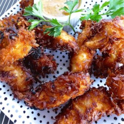 Beer Batter Coconut Shrimp Recipe - Peeled shrimp are dipped in a simple beer batter and coated with sweetened coconut flakes for a quick appetizer or dinner.
