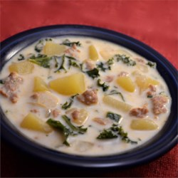 Sausage, Potato and Kale Soup Recipe - Sausage, kale, and potatoes give a creamy Italian-inspired soup a hearty, rich flavor.