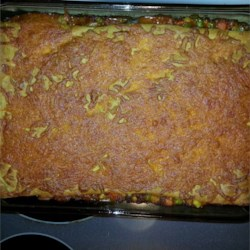 Michele's Ground Beef Casserole Recipe - This ground beef casserole is topped with prepared crescent roll dough and Cheddar cheese.