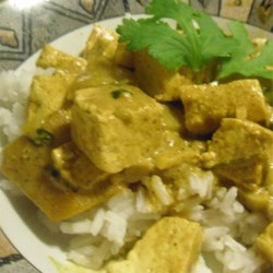 Indian Hot Curried Mangos with Tofu Recipe - Mango slices and tofu cubes are simmered together in curry-seasoned coconut milk.  If you don't like the taste of tofu, chicken or shrimp are easily substituted.