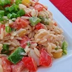 Crab and Orzo Salad Recipe - A spicy dressing mixes perfectly with cool crab meat, tomatoes, and peppers.