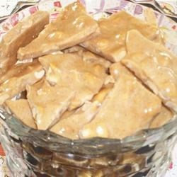 Hot Cinnamon Peanut Brittle Recipe - A fun twist on the original, this brittle tastes like a cross between hot cinnamon candies and traditional peanut brittle.