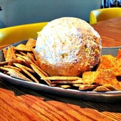 Kati Rose's Cheese Ball Recipe - This classic cheese ball--with the requisite cream cheese base--starts with chopped meat and ends with walnuts.