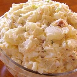 Bacon Potato Salad with Ranch Recipe - This simple bacon potato salad includes hard-boiled eggs, ranch dressing, and Cheddar cheese.