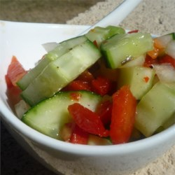 Italian Onion Cucumber Salad Recipe - Use prepared zesty Italian-style salad dressing to marinate a simple salad of cucumber, onion, celery, and bell pepper.