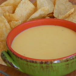 Cheese Dipping Sauce Recipe - Melt real cheddar cheese and prepared mustard for a cheese sauce that 's a far cry from processed.