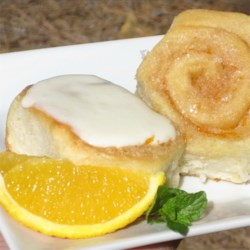Grandma's Orange Rolls with Orange Cream Cheese Frosting Recipe - Orange cinnamon rolls with a sweet, buttery filling and a cream cheese frosting are a crowd-pleasing treat--just like Grandma used to make.