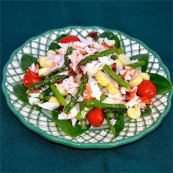 Asparagus and Crab Salad Recipe - A mixture of imitation crabmeat, asparagus, tomatoes, and hearts of palm are dressed with a simple lemon dressing in this salad recipe.