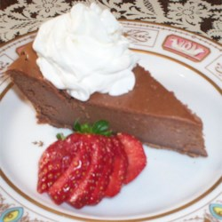Chocolate Lovers Cheesecake Recipe - A very simple but delicious chocolate cheesecake in a chocolate cookie crust.