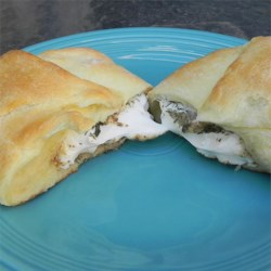 Dilly Cream Cheese in Pastry Recipe - Cream cheese is seasoned with horseradish and dill, then wrapped in a pastry shell and baked to a creamy perfection. Serve with crackers or toasted bread rounds.