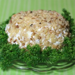Pineapple and Cream Cheese Ball Recipe - Cream cheese and pineapple are rolled in walnuts for a traditional cheese ball. Serve with your favorite cracker!