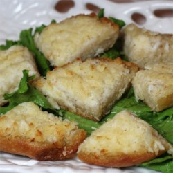 Crabmeat Toasts Recipe - Not unlike a hot crab dip, this creamy seafood mix goes under the broiler on individual bread rounds.