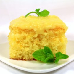 Seven-Up(TM) Cake I Recipe - Coconut cream pudding and lemon-lime soda are baked in a yellow cake and topped with a cooked pineapple sauce.