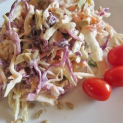Sunflower Coleslaw Recipe - Salted sunflower seed kernels add flavor and crunch to an easy and colorful coleslaw. Flavor is best when the slaw chills overnight.
