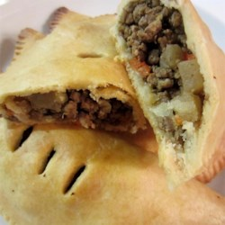 Cornish Pasties III Recipe - Bake up a dozen tasty meat- and veggie- filled pastries with this wonderful recipe. The pastry has lard which makes it flaky and easy to handle. And the filling is the perfect balance of meat and vegetables. Bake them in pie shells or on cookie sheets. Either way, they 're fantastic.
