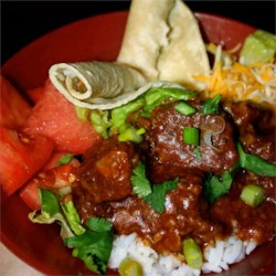 Carne Guisada II Recipe - A Mexican beef stew smothered in a semi-spicy gravy. Simple to make, but tastes wonderful.  Serve with mashed potatoes, rice, and/or homemade tortillas. Cooking time may be cut, but the meat will be less tender.