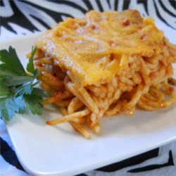 Spaghetti Casserole III Recipe - My Mom has been making this for years. The recipe calls for ketchup and cheddar cheese but can be made with traditional tomato sauce and your favorite Italian cheese.