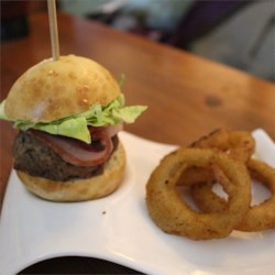 Gourmet Pub Burgers Recipe - Gourmet burgers just like at the pub are quick and easy to make with Dijon mustard-infused hamburger patties topped with a slice of pancetta.