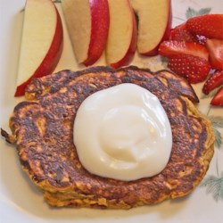 Savory Butternut Squash Pancakes Recipe - Add a new twist to regular pancakes by adding cooked squash, currants, and shallots to the batter. Top with sour cream for a savory breakfast treat.