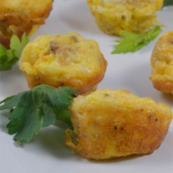 Potato and Chorizo Mini Quiches Recipe and Video - These mini quiches are a great party snacks. Filled with spicy chorizo, potatoes, and cheese, they can be garnished with garlic mayonnaise and fresh chives.
