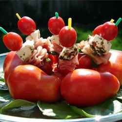 Mozzarella and Tomato Appetizer Recipe - Fresh grape or cherry tomatoes, prosciutto, fresh basil leaves and marinated mozzarella, speared with a cocktail toothpick, make a colorful and tasty appetizer.