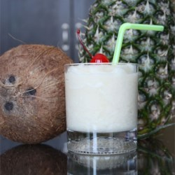 Pina Colada Cocktail Recipe - The pina colada is a blended drink that originated in Puerto Rico. The mixture of pineapple, coconut, and rum is a taste of the tropics.