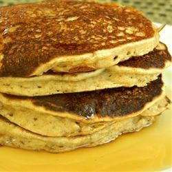Whole Grain Banana Pancakes Recipe - Oats lend texture to these banana pancakes made with almond meal and whole wheat flour.