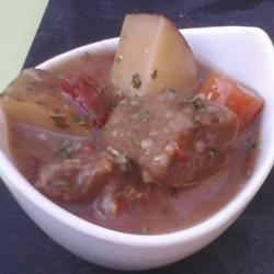 Greek Style Beef Stew Recipe - This Greek-style beef stew is filled with potatoes, carrots, onions, tomatoes, and spices. A little red wine and wine vinegar adds additional depth of flavor.
