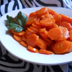 Easy Glazed Carrots Recipe - Make an easy side dish of carrots glazed with butter, brown sugar, and orange marmalade in the microwave. It makes a great kid's snack, too.
