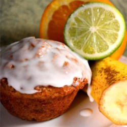 Banana Mango Muffins with Lime Glaze Recipe - Mango and banana are pureed and folded into muffin batter creating a tropical twist for a breakfast treat.