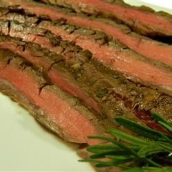 Grilled Balsamic and Soy Marinated Flank Steak Recipe - Soy sauce, balsamic vinaigrette, onion, and garlic combine for a tasty marinade, ideal for flank steak before going on the grill.