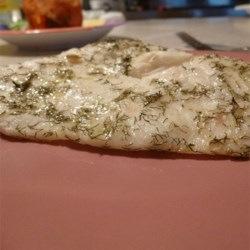 Grilled Halibut I Recipe - The citrus marinade used in this recipe is made with sprigs of fresh marjoram.  One or two hours of marinating is all that is required: a longer period affects the texture of the fish.