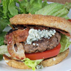 Bacon and Blue Cheese Burgers Recipe - Outdoor cooking, in America, means busting out your best burger recipe for the grill. This recipe mixes bacon, blue cheese, hot pepper sauce, and steak sauce into each bite.