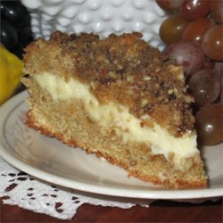 Polish Cream Cheese Coffee Cake Recipe - A moist coffee cake with a sweet cream cheese center and crunchy pecan topping is the perfect treat to serve at your next brunch.