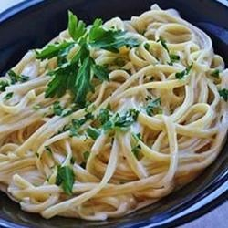 Easy Alfredo Sauce I Recipe - A heavenly convergence of whipping cream, butter and Parmesan cheese cooks down effortlessly into a velvety, classic Alfredo sauce. You may never go back to the store-bought variety.