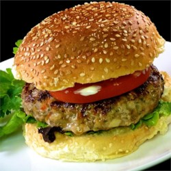 Asian Turkey Burgers Recipe - Give a taste of Asia to turkey burgers through the addition of soy sauce, ginger, and garlic when you want something different from your burgers.