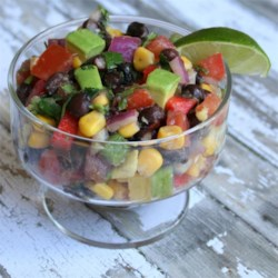 Black Bean Avocado Salsa Recipe - Black beans, avocado, corn, and roma tomatoes make the base of this salsa with a healthy dose of lime juice.