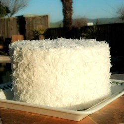 Coconut Cake IV Recipe - Coconut extract, flaked coconut, and buttermilk flavor this moist butter cake.