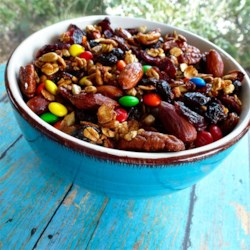 Tasty Maple Trail Mix Recipe - Make your own granola to take with you on the trail. This snack is packed with cranberries, pecans, and chocolate covered peanuts.